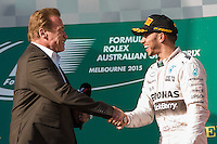 March 15, 2015: Arnold Schwarzenegger congratulates Lewis Hamilton (GBR) #44 (1st) on the podium at the 2015 Australian Formula One Grand Prix at Albert Park, Melbourne, Australia. Photo Sydney Low