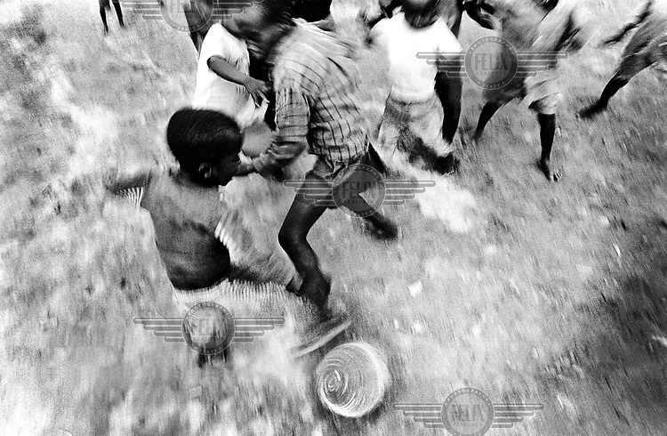 Boys playing football. Democratic Republic of Congo (formerly Zaire).