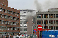 (July22,2010)Smoke billows from government offices after a large vehicle bomb was detonated near the offices of Norwegian Prime Minister Jens Stoltenberg on 22 July 2011. Although Stoltenberg was reportedly unharmed the blast resulted in several injuries and deaths. <br /> Another terrorist attack took place shortly afterwards, where a man killed over 80 children and youths attending a political camp at Ut&oslash;ya island. <br /> Anders Behring Breivik was arrested on the island and has admitted to carrying out both attacks.<br /> (photo:Fredrik Naumann/Felix Features)