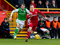 7th March 2020; Pittodrie Stadium, Aberdeen, Scotland; Scottish Premiership Football, Aberdeen versus Hibernian; Christian Doidge of Hibernian and Lewis Ferguson of Aberdeen compete for possession of the ball