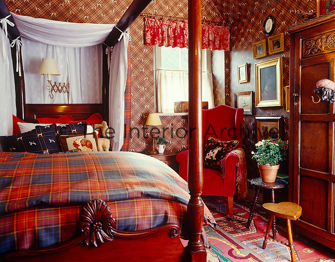 This cosy single bedroom is a riot of tartan, checks and florals in various tones of red