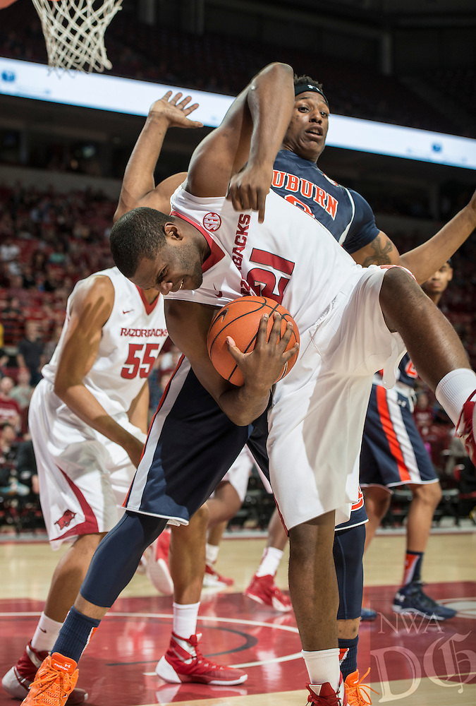 NWA Democrat-Gazette/ANTHONY REYES &bull; @NWATONYR<br /> Arkansas Razorbacks guard Manuale Watkins (21) grabs a rebound in front of Auburn Tigers forward Horace Spencer (0) in the first half Wednesday, Feb. 17, 2016 at Bud Walton Arena in Fayetteville.