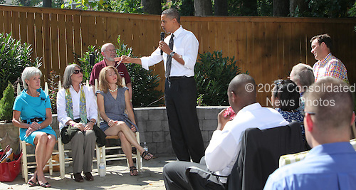 United States President Barack Obama answers questions about the Health Care Plan with a group in the backyard of the home of Paul and Frances Brayshaw in Fairfax, Virginia on Wednesday, September 22, 2010..Credit: Dennis Brack / Pool via CNP