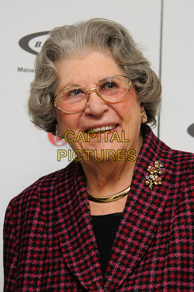 Baroness Trumpington.The Oldie Of The Year Awards 2012 at Simpsons On The Strand, London, England..7th February 2012.headshot portrait purple pink red check brooch gold necklace glasses black.CAP/CJ.©Chris Joseph/Capital Pictures.