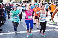 Runners pass through the Williamsburg neighborhood of Brooklyn, New York during the 2014 TCS NYC Marathon on November 2, 2014.