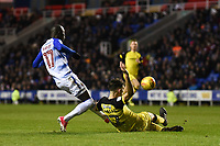 Modou Barrow of Reading has a shot blocked by Tom Flanagan of Burton Albion during the Sky Bet Championship match between Reading and Burton Albion at the Madejski Stadium, Reading, England on 23 December 2017. Photo by Paul Paxford.