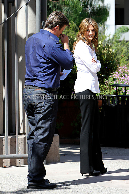 WWW.ACEPIXS.COM . . . . .  ....August 9, 2012, Los Angeles, CA........Actors Stana Katic and Nathan Fillion  on the set of the television show 'Castle' on August 9, 2012 in Los Angeles, CA....Please byline: NANCY RIVERA- ACEPIXS.COM.... *** ***..Ace Pictures, Inc:  ..Tel: 646 769 0430..e-mail: info@acepixs.com..web: http://www.acepixs.com