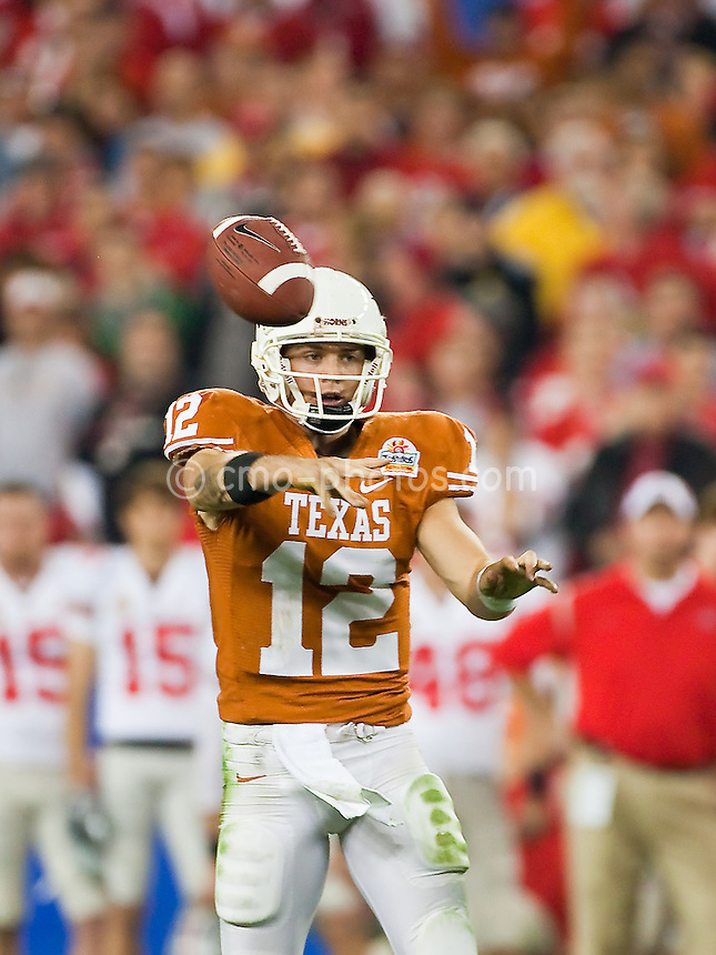 Jan 05, 2009; Glendale, AZ, USA; Texas Longhorns quarterback Colt McCoy (12) throws the ball in the third quarter of the Fiesta Bowl against the Ohio State Buckeyes at University of Phoenix Stadium.  The Longhorns won the game 24-21.