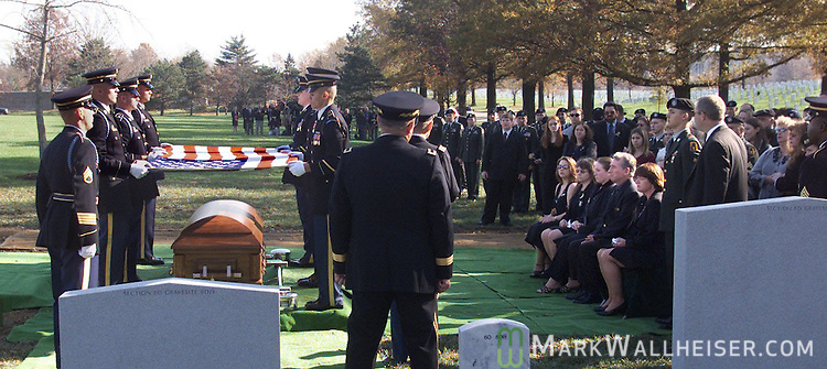 The scene of Spc Robert Allen Wise's funeral service at Arlington National Cemetery in Washington, DC.  In the front row are from left (girlfriend Jenny Walsh, stepmother Jeannine Wise, sister Marie Hildinger, father David Wise and mother Tammy Wise on November 24, 2003..