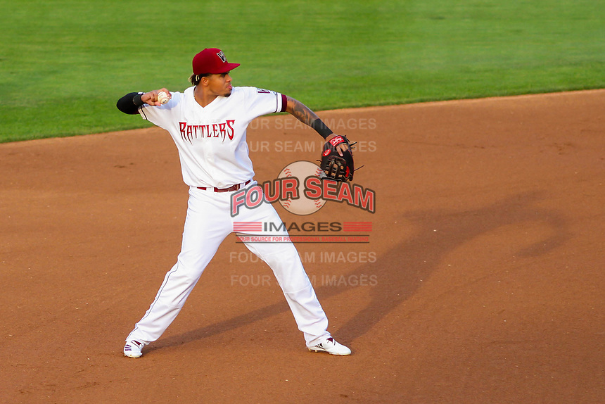 Wisconsin Timber Rattlers shortstop Gilbert Lara (11) throws to first base during a Midwest League game against the Burlington Bees on August 3, 2018 at Fox Cities Stadium in Appleton, Wisconsin. Wisconsin defeated Burlington 5-4. (Brad Krause/Four Seam Images)