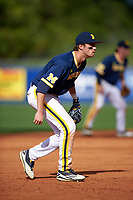 Michigan Wolverines third baseman Jake Bivens (18) during the second game of a doubleheader against the Canisius College Golden Griffins on February 20, 2016 at Tradition Field in St. Lucie, Florida.  Michigan defeated Canisius 3-0.  (Mike Janes/Four Seam Images)