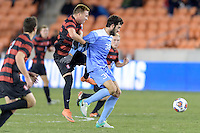 Houston, TX - Friday December 9, 2016: Corey Baird (10) of the Stanford Cardinal and Tucker Hume (36) of the North Carolina Tar Heels battle for control of the ball at the NCAA Men's Soccer Semifinals at BBVA Compass Stadium in Houston Texas.