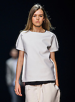 Models showcase design on the runway during Calvin Klein Platinum Label Spring 2014 Runway Show on 24 October 2013 at the Shaw Studios in Hong Kong, China. Photo by Victor Fraile / StudioEast.