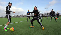 SWANSEA, WALES - JANUARY 28: (L-R) Jack Cork and Leon Britton in action during the Swansea City Training Session on January 28, 2016 in Swansea, Wales.