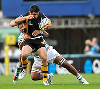 High Wycombe, England. Andrea Masi of London Wasps tackled during the Aviva Premiership match between London Wasps and London Irish at Adams Park on September,15 2012 in High Wycombe, England.
