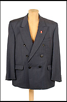 BNPS.co.uk (01202 558833)Pic: Astons/BNPS<br /> <br /> Snappy Suit - with a camera concealed in a button.<br /> <br /> Cold War Collectables - Auction of Soviet spy camera's from behind the Iron Curtain reveal the KGB's cunning and ingenuity at the height of the Cold War.<br /> <br /> A fascinating collection of Russian spy cameras which were used clandestinely at the height of the Cold War have emerged for sale for &pound;60,000.<br /> <br /> The ingenious gadgets deployed by KGB operatives include cameras built into the sides of briefcases, buttons of jackets, umbrella handles and cigarette cases.<br /> <br /> The sale also features a clever 'Zenit' F-21 spy camera which shoots photos through the side of a camera case when it appears to be shut.<br /> <br /> There are also several 'Minox' cameras which are known as the 'James Bond' spy camera as one appeared in the film On Her Majesty's Secret Service (1969).