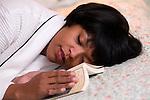 Woman sleeping with book