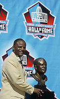 Warren Moon, the first African American quarterback to be inducted into the hall of fame, poses with his bust during the Pro Football Hall of Fame induction ceremony Saturday, Aug. 5, 2006, in Canton, Ohio.<br />