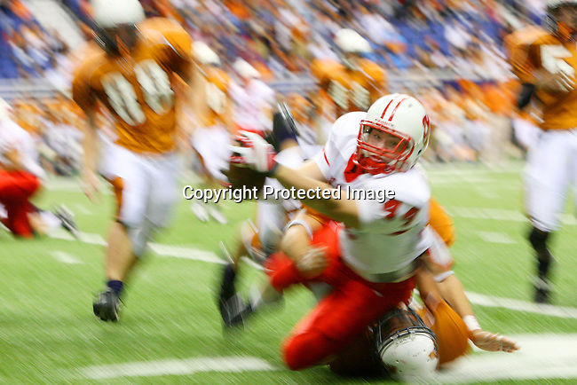 Katy junior Chris Roberson keeps his eye on the first down marker.  The Katy Tigers advanced to the Texas 5A Championship round by defeated San Antonio Madison 66-21 at the Alamodome in San Antonio December 15, 2007.