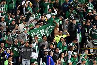 BOGOTÁ - COLOMBIA, 23-10-2018: Hinchas de Deportivo Cali (COL), animan a su equipo durante partido de ida entre Independiente Santa Fe (COL) y Deportivo Cali (COL), de los cuartos de final, S1 por la Copa Conmebol Sudamericana 2018, en el estadio Nemesio Camacho El Campin, de la ciudad de Bogotá. / Fans of Deportivo Cali (COL), cheer for their team during a match of the first leg between Independiente Santa Fe (COL) and Deportivo Cali (COL), of the quarterfinals, S1 for the Conmebol Sudamericana Cup 2018 in the Nemesio Camacho El Campin stadium in Bogota city. Photo: VizzorImage / Luis Ramírez / Staff.