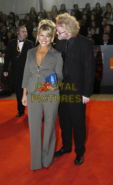 BILLIE PIPER & CHRIS EVANS.Bafta Awards - British Academy Awards at Odeon Leicester Square.15 February 2004.full length, full-length, grey trouser suit, tanned skin, whispering.www.capitalpictures.com.sales@capitalpictures.com.©Capital Pictures