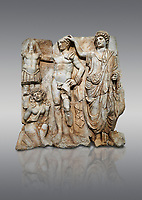 "Roman Sebasteion relief  sculpture of the Emperor and Roman People, Aphrodisias Museum, Aphrodisias, Turkey. <br /> <br /> The emperor is a naked warrior and is crowned by a personification of the Roman People or the Senate wearing a toga, the stately civilian dress of a Roman Citizen. The crown is an oak wreath, the corona civica or ""civic crown"" awarded for saving citizens lives. The emperor is setting up a battlefield trophy beneath which kneels an anguished barbarian women captive"