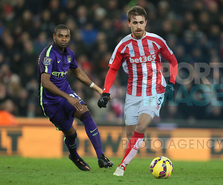 Marc Munlesa of Stoke City turns Fernandinho of Manchester City - Barclays Premier League - Stoke City vs Manchester City - Britannia Stadium - Stoke on Trent - England - 11th February 2015 - Picture Simon Bellis/Sportimage