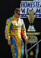 Nov. 16, 2008; Homestead, FL, USA; NASCAR Sprint Cup Series driver Bobby Labonte walks by the championship trophy prior to the Ford 400 at Homestead Miami Speedway. Mandatory Credit: Mark J. Rebilas-