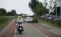 Yet another car has entered the race echelon...<br /> The breakaway group is only 7 (behind the police motors) and can avoid him by staying wide coming down.<br /> Too many of these incidents kept happening along this stage.<br />  <br /> stage 3: Buchten-Buchten (190km)<br /> 29th Ster ZLM Tour 2015