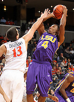 Jan. 2, 2011; Charlottesville, VA, USA; LSU Tigers guard Chris Bass (4) shoots over Virginia Cavaliers guard Sammy Zeglinski (13) during the game at the John Paul Jones Arena. Mandatory Credit: Andrew Shurtleff-