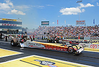 Jun. 2, 2012; Englishtown, NJ, USA: NHRA top fuel dragster driver Clay Millican (near lane) races alongside Bruce Litton during qualifying for the Supernationals at Raceway Park. Mandatory Credit: Mark J. Rebilas-