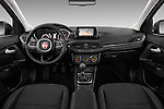 Stock photo of straight dashboard view of 2016 Fiat Tipo Lounge 5 Door Hatchback Dashboard