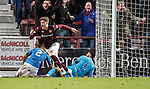 Robbie Muirhead beats James Tavernier and Wers Foderingham to score for Hearts and celebrates