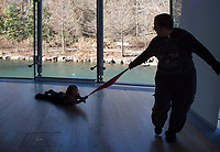 NWA Democrat-Gazette/CHARLIE KAIJO Robin Hunt of Noel Mo. (from right) plays a game with Quinn Hunt 5, during the Noon Year's Eve event on Sunday, December 31, 2017 at Crystal Bridges in Bentonville. Visitors rang in the New Year (without staying up past bedtime) at the third annual family celebration including arts projects, performances and a family dance party.