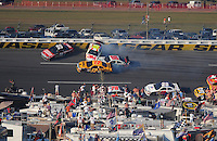 Oct 5, 2008; Talladega, AL, USA; NASCAR Sprint Cup Series driver Greg Biffle (16), Carl Edwards (99), Matt Kenseth (17) and Dale Earnhardt Jr (88) crash during a multi-car accident in the Amp Energy 500 at the Talladega Superspeedway. Mandatory Credit: Mark J. Rebilas-