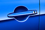 Closeup of a blue car door handle on a 2010 Mitsubishi Lancer Sportback