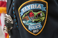 Elyria Police badge is seen during a police memorial parade in Ottawa Sunday September 26, 2010.
