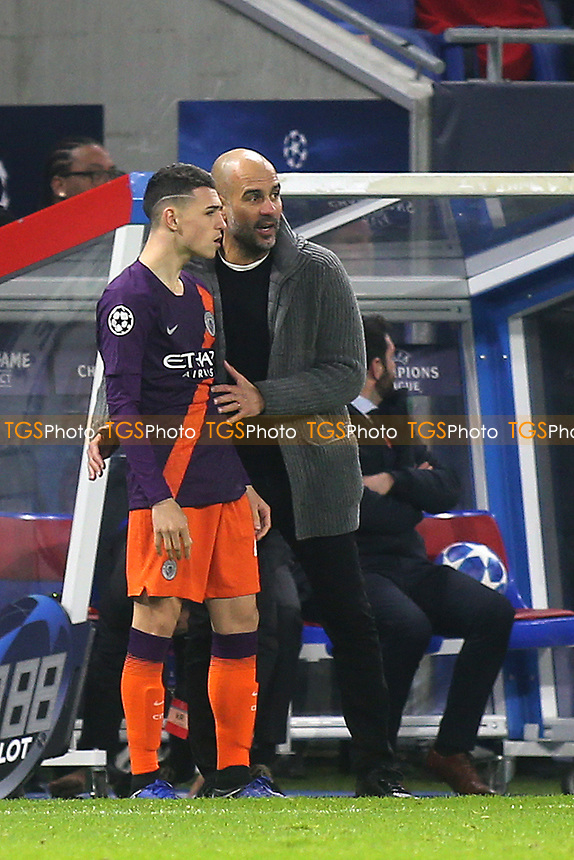 Manchester City Manager, Pep Guardiola, has a few words with Phil Foden prior to him going on as a second half substitute during Lyon vs Manchester City, UEFA Champions League Football at Groupama Stadium on 27th November 2018