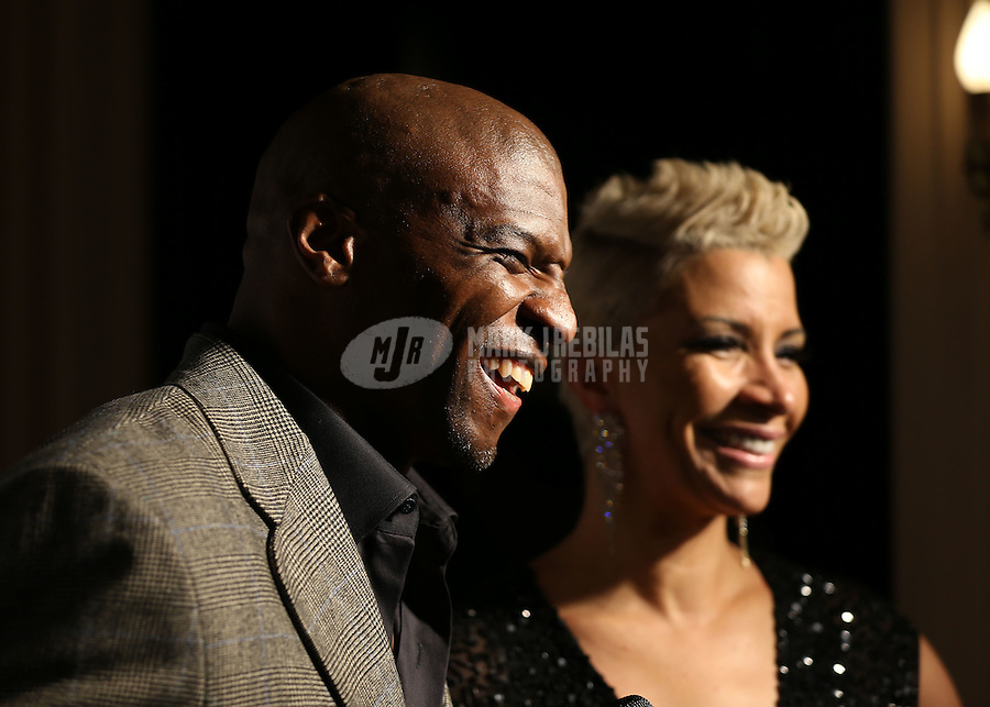 Feb. 2, 2013; New Orleans, LA, USA: Television actor Terry Crews (left) with wife Rebecca King-Crews on the red carpet prior to the GQ Party at the Elms Mansion leading up to Super Bowl XLVII. Mandatory Credit: Mark J. Rebilas-USA TODAY Sports