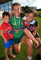 Manawatu captain Selica Winiata with her nephews after winning the women's cup final. Day two of the 2018 Bayleys National Sevens at Rotorua International Stadium in Rotorua, New Zealand on Sunday, 14 January 2018. Photo: Dave Lintott / lintottphoto.co.nz