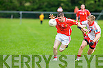 An Ghaeltacht's Cian O Murchu gets away from East Kerry's Gavin Kelly in the minor County championship final at Killorglin on Saturday.