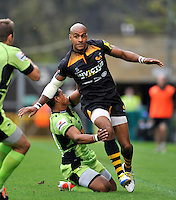 High Wycombe, England. Tom Varndell of Wasps in action during the Aviva Premiership match between Wasps and Northampton Saints at Adams Park on September 14, 2014 in High Wycombe, England.