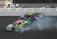 Mar 1, 2008; Las Vegas, NV, USA; Nascar Nationwide Series driver Marcos Ambrose (59) spins as Brad Coleman (27) goes high to avoid him during the Sams Town 300 at the Las Vegas Motor Speedway. Mandatory Credit: Mark J. Rebilas-US PRESSWIRE