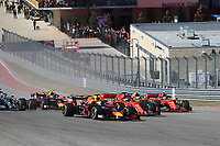 3rd November 2019; Circuit of the Americas, Austin, Texas, United States of America; Formula 1 United Sates Grand Prix, race day; Scuderia Ferrari, Sebastian Vettel and team mate Charles Leclerc are out-manouvefred by the overtake from Aston Martin Red Bull Racing, Max Verstappen as they go three wide into Turn 1