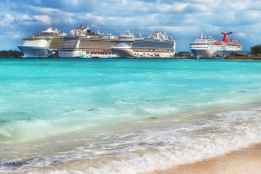 a line up of cruise ships in port at nassau in the bahamas