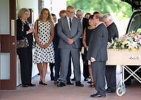 "Pictured: Rachel Stewart (L) and Eve Stewart (2ndL) who wears a spotty dress, the daughter and granddaughter of Pat Stewart are joined by close family and relatives stand as the coffin of Pat Stewart arrives<br /> Re: The funeral of Pat Stewart at the Cardiff and Glamorgan Memorial Park and Crematorium, Wales, UK. Pat Stewart became famous as ""the girl in the spotty dress"" after an iconic image taken by Bert Hardy in Blackpool in 1951."