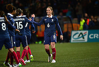 Lorient, France. - Sunday, February 8, 2015:  Amandine Henry (6) of France celebrates with teammates after the match. France defeated the USWNT 2-0 during an international friendly at the Stade du Moustoir.