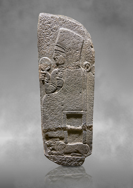 Hittite monumental relief sculpted orthostat stone panel of a Procession Basalt, Karkamıs, (Kargamıs), Carchemish (Karkemish), 900 - 700 B.C. Anatolian Civilisations Museum, Ankara, Turkey.<br /> <br /> Goddess Kubaba. End of pannels. The godess is saeted on a chair which is on a lion. she hold a mirror in her right hand and a pomegranate in her left.<br /> <br /> Against a grey art background.