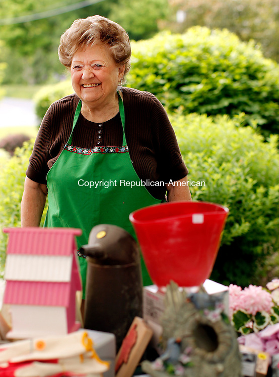 Woodbury, CT-22, May 2010-052210CM08 COUNTRY LIFE USEHarriet Mays, of Southbury and member of the First Congregational Church volunteers at the craft table, at the Woodbury Bloomin Fair in Woodbury Saturday morning. --Christopher Massa Republican-American