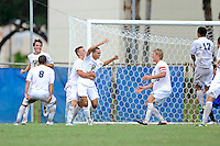2 October 2011:  FIU's team (pictured, Anthony Hobbs (16), Nicholas Chase (8), Quentin Albrecht (22, hugging De Sousa), John Kite (15)), celebrates an overtime goal by Roberto De Sousa (20) as the FIU Golden Panthers defeated the University of Kentucky Wildcats, 1-0 in overtime, at University Park Stadium in Miami, Florida.